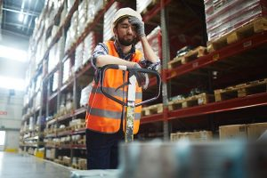 Tired Worker Falling Asleep at the Forklift - Workplace Fatigue