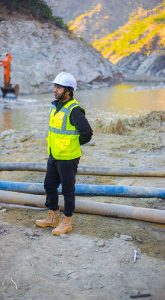 Man standing on job site - Improve your bottom line with workplace safety and health