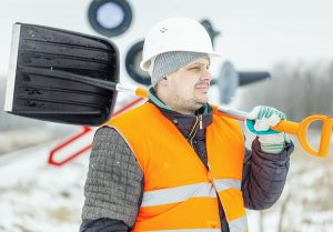 Man working outside in cold weather - Cold weather work risks and tips - Worksite Medical