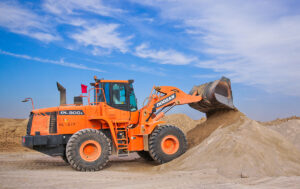 Excavator in sand - silica dust safety in construction