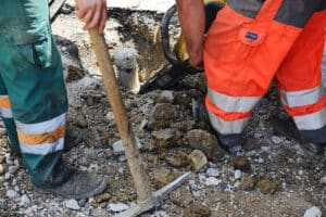 Workers drilling asphalt - WHO reveals cause of nearly 2 million workplace deaths